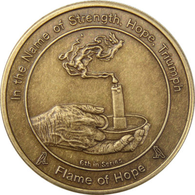 coin six flame of hope showing hands holding an alit candlestick