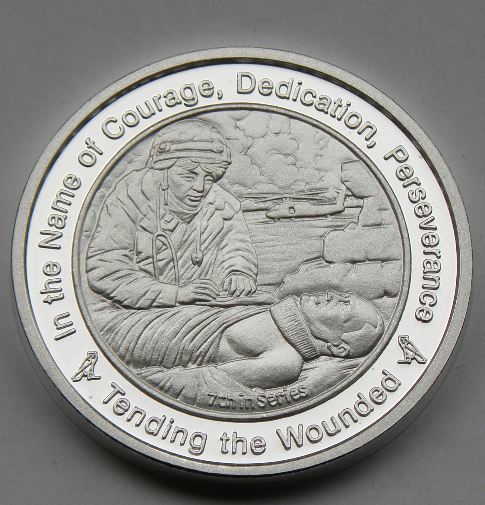 tending the wounded coin in fine silver