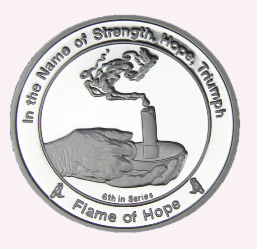 coin six flame of hope coin showing hands holding an alit candle stick