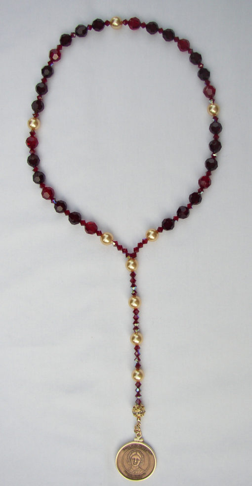 garnet beads with bronze medallion