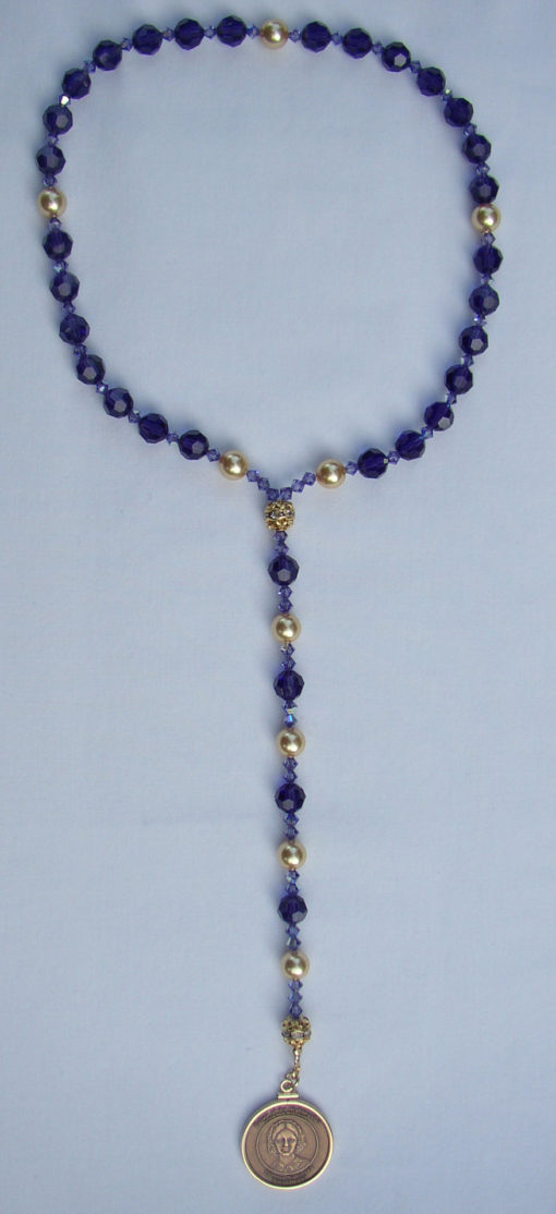 Blue beads with bronze medallion