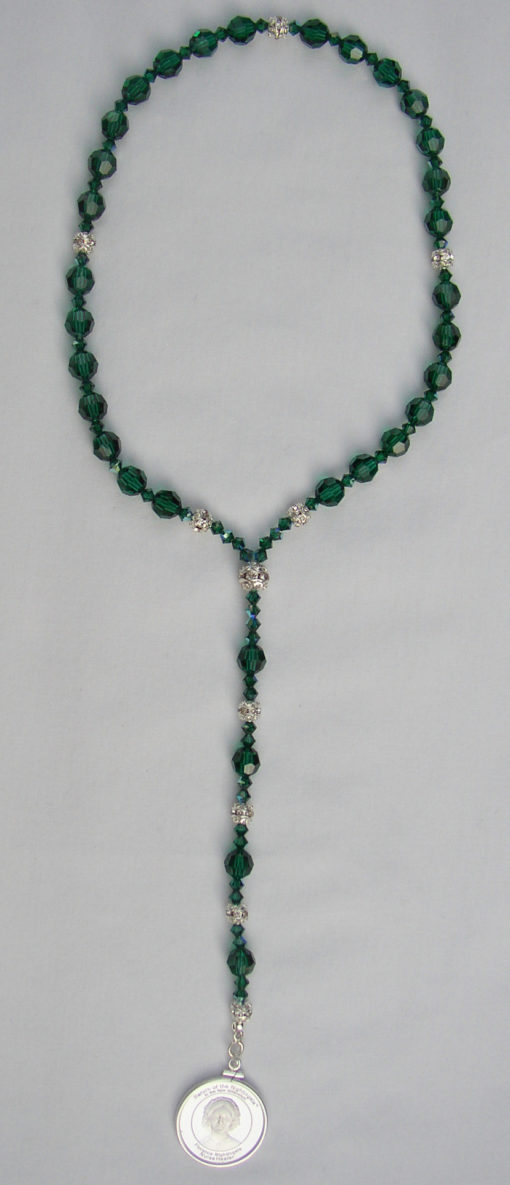 emerald beads with silver medallion