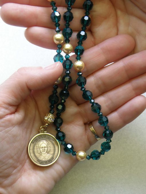 emerald beads with bronze medallion
