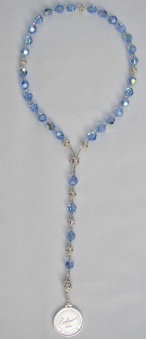 Light blue beads with silver medallion